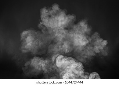 White smoke texture on a black background. Texture and abstract art