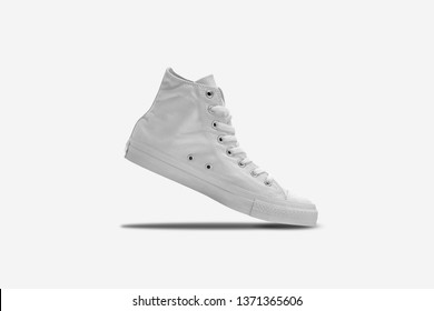 White sneakers isolated on white background. High Resolution Photo.