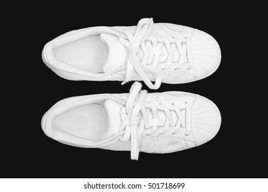 White Sneakers isolated on black background