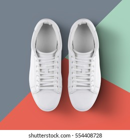 White sneakers isolated  on colorful background with clipping path