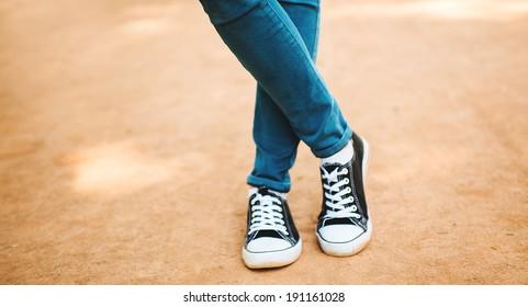 white sneakers on girl legs