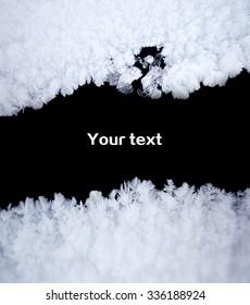 white snow against black background