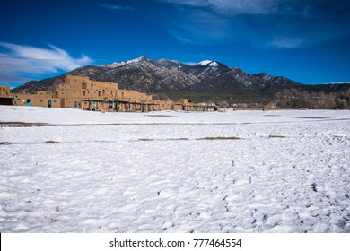 White snow covered Taos Pueblo New Mexico the land of Enchantment and home to the Southern Sangre De Cristo Mountains of the desert Southwest and native tribes