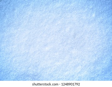 White snow in freezing blue tone on ground for background.