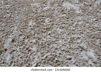 white snow and ice on brown grass or lawn