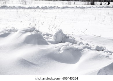white snow pile lumps