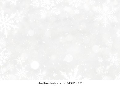 White snowflakes and blured bokeh christmas background