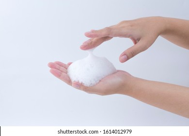 white Soapy foam bubbles texture on woman hand