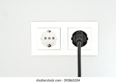 White socket. Power socket. White outlet on the wall.