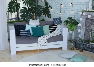 white sofa and paulette the sofa by the fireplace big flower next to the