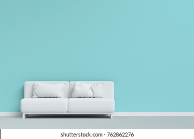 white sofa with pillow on the floor in mint green living room. minimal style concept.