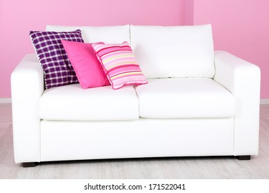White sofa in room on pink background