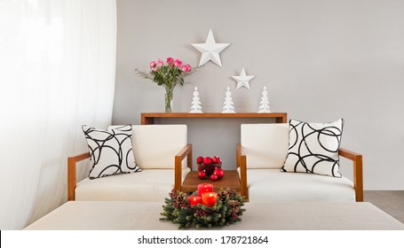 White sofa seat in Christmas setting and with flowers