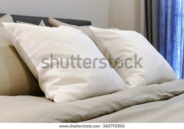 white soft pillows on the comfortable  bed