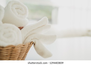 white spa towels in a basket