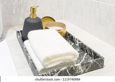 White spa towels on washbasin sink in hotel bathroom