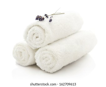 White spa towels pile with lavender on white background
