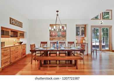 White spacious dining area with built in cabinets and natural hardwood floor.