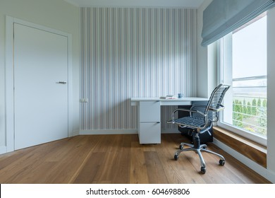 White spacious study room with wooden parquet and stripes on the wall