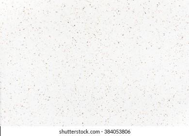 white speckled confetti background. / warm white paper texture