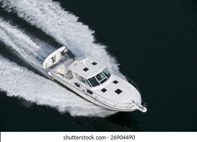 A white speedboat shot from above while traveling fast.