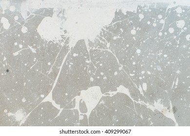 White splash on gray background concrete wall, messy, splotchy, surface. Decorative wet paint drops, abstract art.