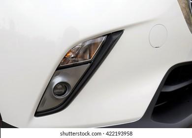 White sport car headlights