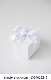 White square box with silk ribbon on white background
