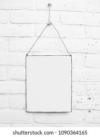 White square metal plate banner sign on white brick background - mock up - template