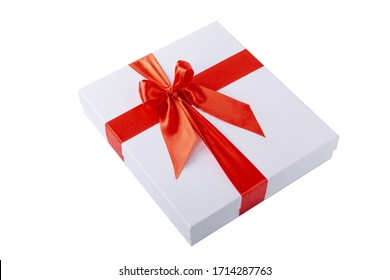 A white square paper gift box with a red ribbon isolated on white background.