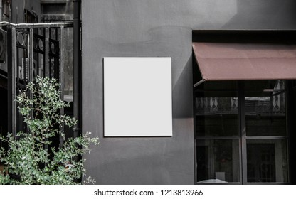 White square signboard on the wall