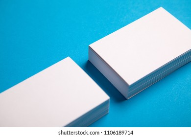 white stacks of business cards on blue background