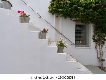 White staircase decorated with flowers at Naoussa village of Paros