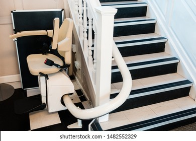White stairlift on staircase for disabled people and elderly people indoor in home or school and office for free service.