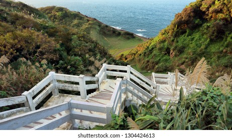 White stairs to beachfront ocean view.