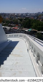 white stairs on the high building in sunny day with city view and blue sky