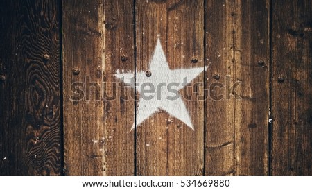 White Star Shape Stencil Painted On Old Vintage Retro Wood Background