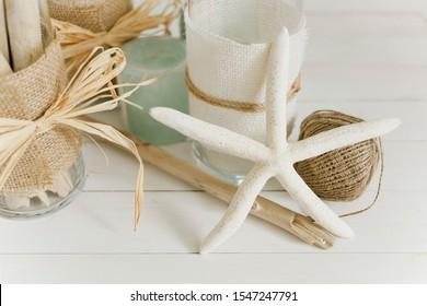 White starfish and coastal decor on white wood table