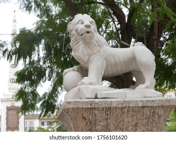 White statue of lion in park soemwhere in Malaga