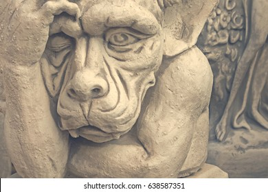 White statue of the mythological monster. Toned
