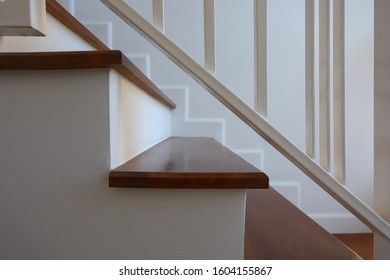 white steel balustrade on brown wooden stair interior decorated modern style of residential house