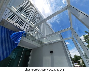 White steel frame structure of glasshouse in luxurious modern residential background
