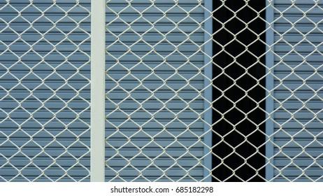 white steel grating front the blue metal door