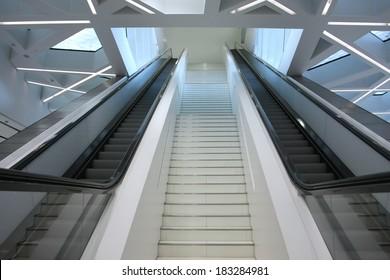 white steps and escalator