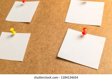 white stickers for notes on a cardboard background