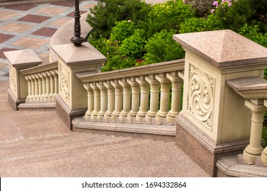 White stone balusters. Baroque balustrade. Outdoor sandstone stairs and balustrades. The detail with depth of field of balustrade with beige sandstone. sandstone architecture. sandstone railing.granit