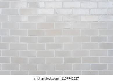 White stone brick wall seamless background and pattern