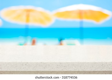 White stone countertop on blurred beach background - can be used for display or montage your products