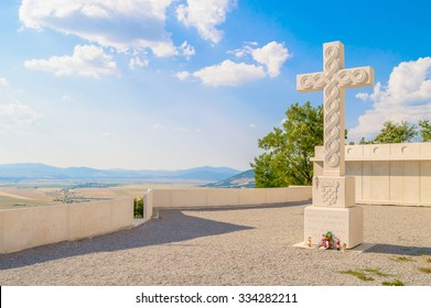 White stone cross with croatian interlace or wattle over the Krbava field in Croatia, a monument to all croatian martyrs