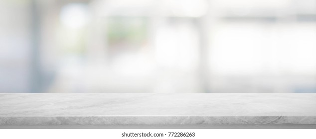 White stone marble table top and blurred abstract background from interior building banner background - can used for display or montage your products.